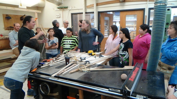 Wayne explains process of making LaCrosse sticks to ENGAGE girls and teachers