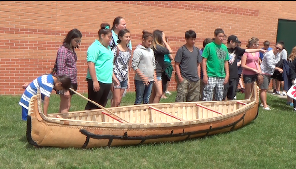 ENVISION students and Wayne with canoe
