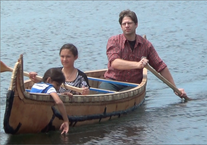 Tim Frandy taking Ojibwe ENGAGE students for a ride in the canoe, June 2014 Lac du Flambeau