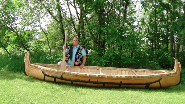 Wayne posing with finished canoe, Lac du Flambeau