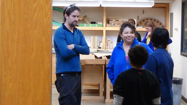 ENGAGE boys and teacher visit with UW graduate student in wood shop