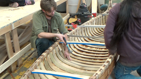 final rib being added at center of canoe