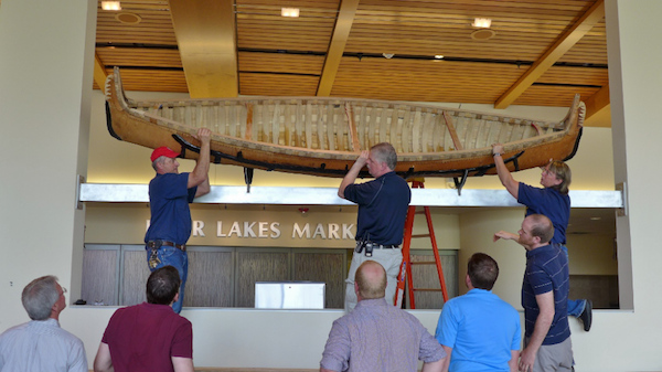 Canoe being lifted into place in Dejope Hall