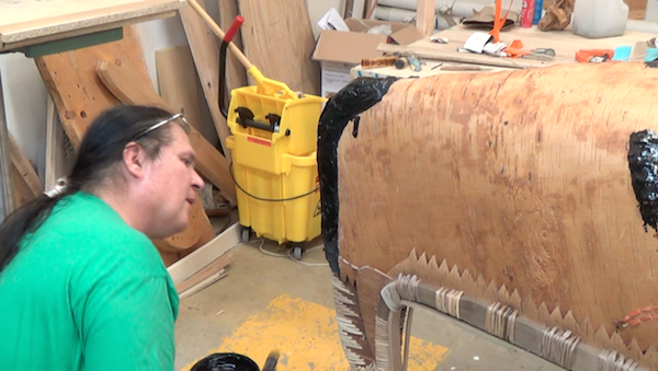 Applying pitch to the nose of the canoe