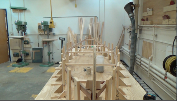 gunwales in place in woodshop, drying