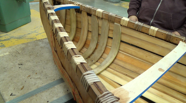 shaped and honed ribs are installed into canoe with sheathing