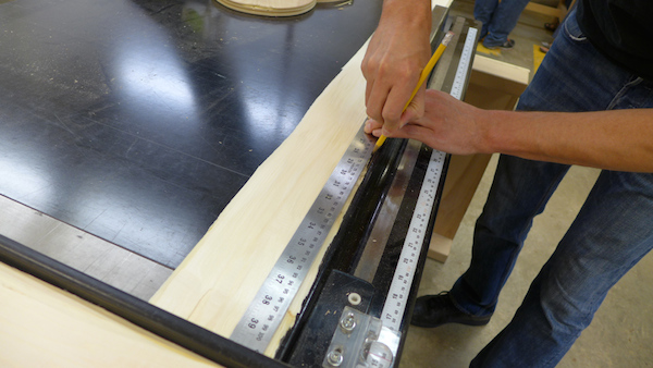 sheathing piece being cut on a table saw