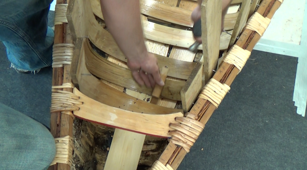 tapping rib into place with sheathing